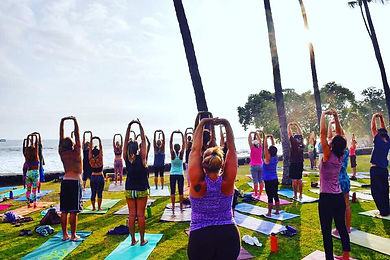 Big group stretching on International Yoga Day in Hawaii
