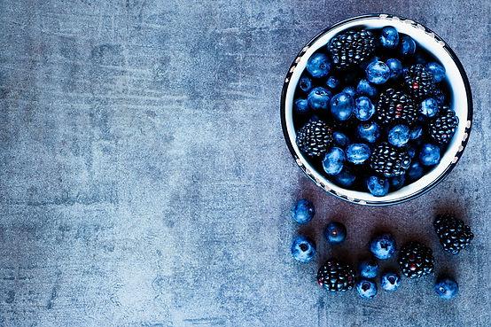Organic fresh dark berries in vintage mu