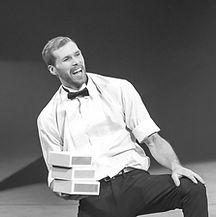 Eric Bates holding cigar boxes at cirque de demain circus fesival
