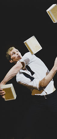 Eric Bates juggling cigar boxes with barcode circus company