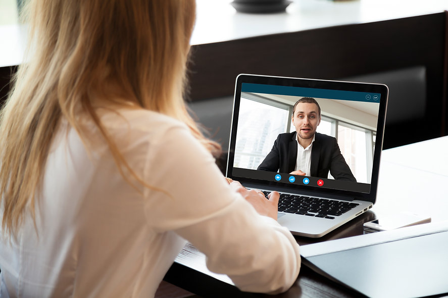Businesswoman making video call to busin