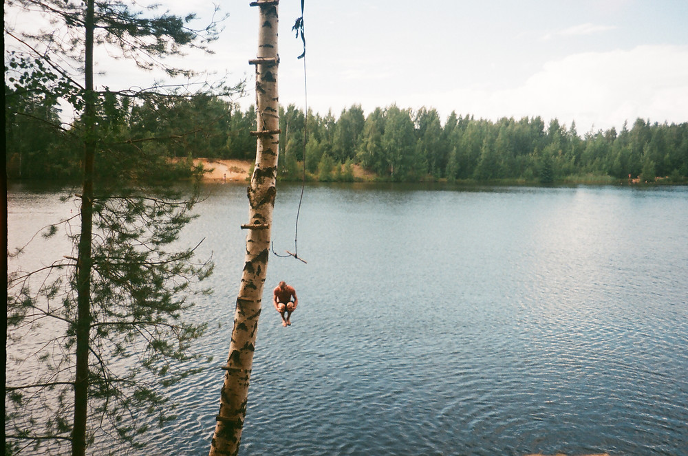 Man cannonballing into lake