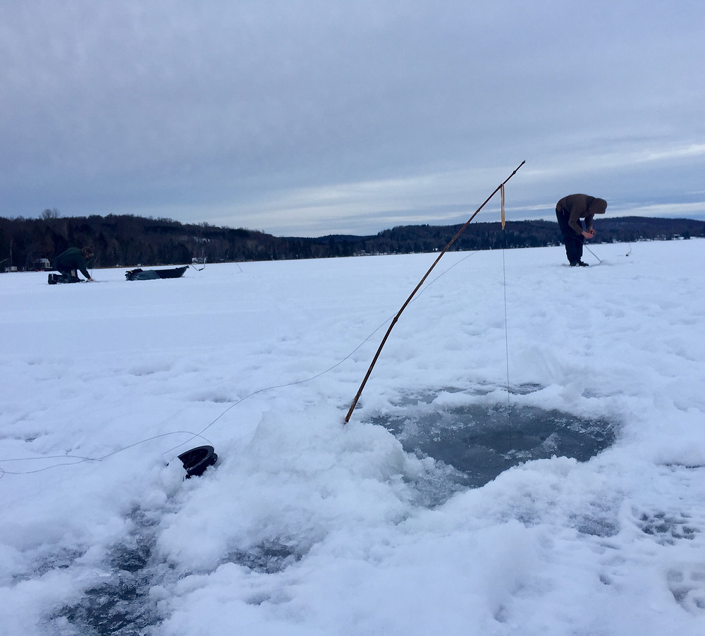 Ice fishing with a stick on Beech Lake
