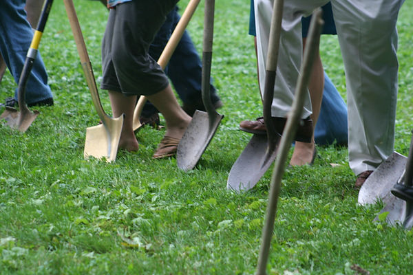 ground breaking shovels and feet.JPG
