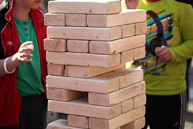 playing-in-wooden-brick-game-giant-jenga