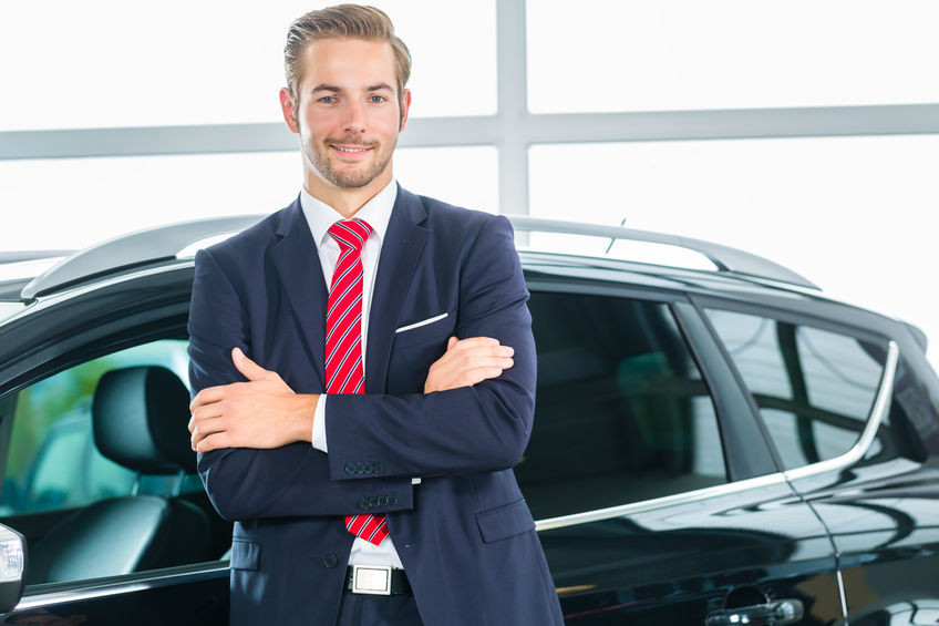 negotiating with a car salesman in West Bloomfield