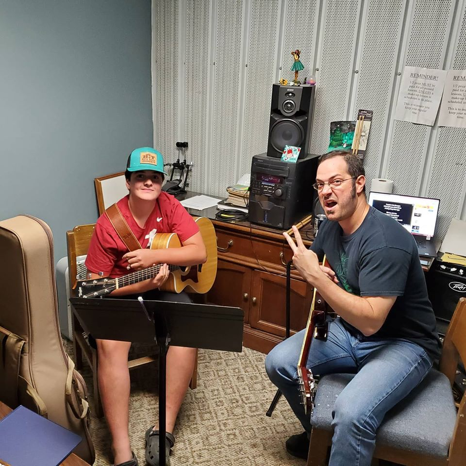 Student Lane Talley At His Guitar Lesson
