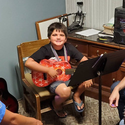 Oakly Jolly At His Guitar Lesson Today W
