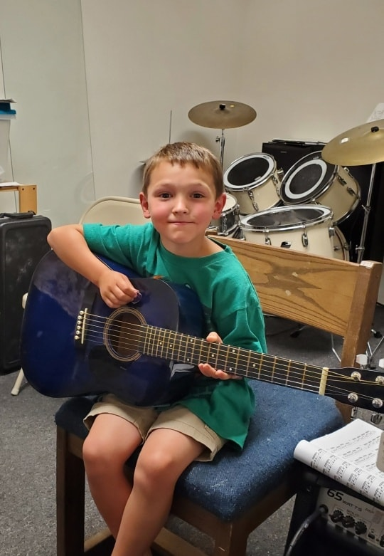 Student Isaac Nunn At His Guitar lesson
