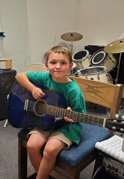 Student Isaac Nunn At His Guitar lesson