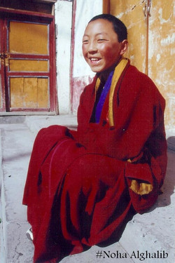 buddhist boy at Jiuzhaigou, China