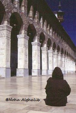 Woman pray at Umayyad Mosque,Syria