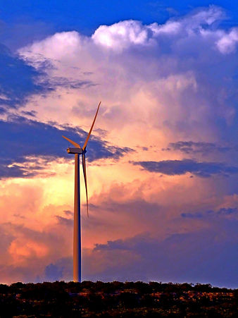 Wind turbine against a Texas sunset