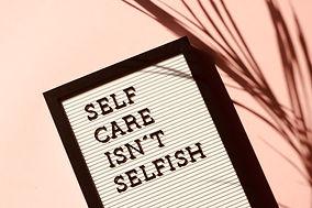 Canva - Self Care Isn't Selfish Signage.