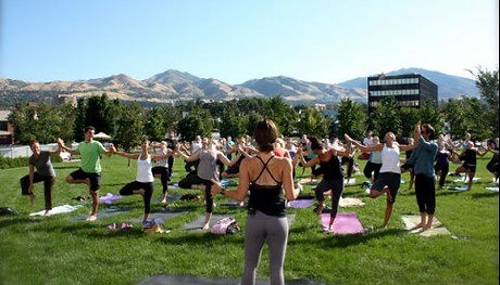Jen & Matt Newman teaching outdoor yoga class