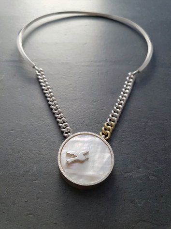 Medallion with bird on handmade chain and collar necklace from Nat McIntosh Jewellery