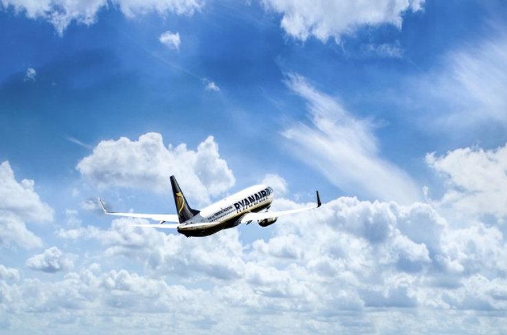 jet-plane-in-a-blue-cloudy-sky.jpg