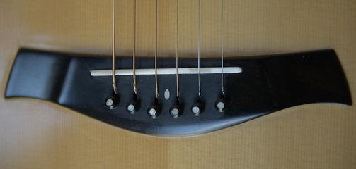puente guitarra acustica