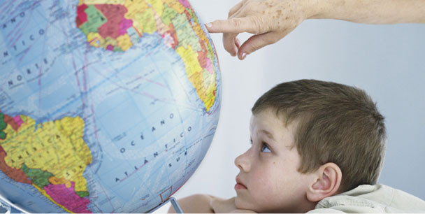 Child looking at Globe Earth