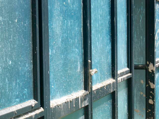 Peelable Protective Coating being used as window protection during construction