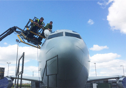 peelable protective coating being applied to an aircraft