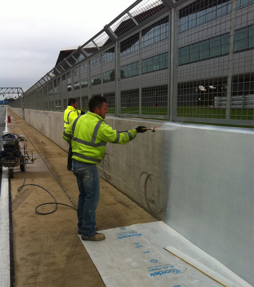 protective coating being applied to concrete wall