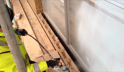 Protectapeel being applied to glass and windows to be used as window protection