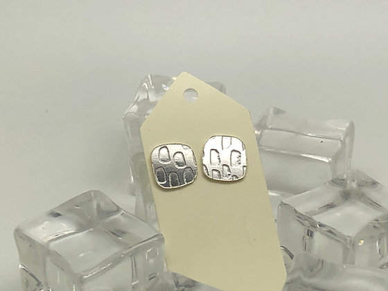 One off , etched silver studs