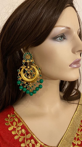 Big earrings with green pearls.