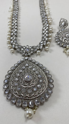Silver with stone long necklace set with matching earrings and tikka