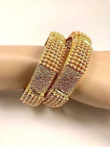 Gold plated bangles with cream pearl