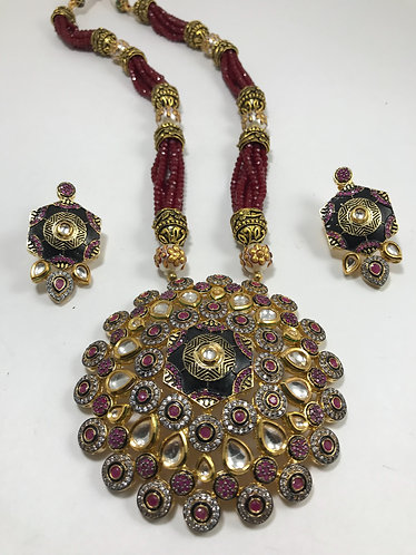 Kundan n CZ Maroon big pendant with gold plated art design