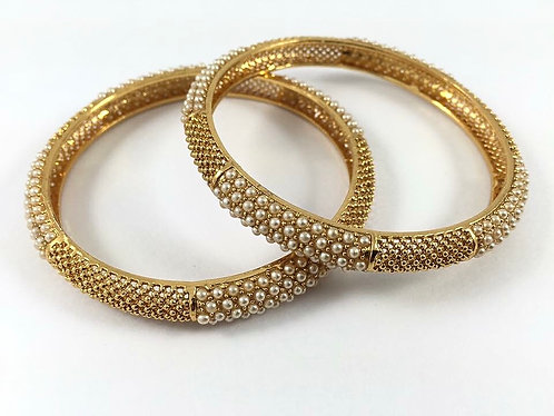 Gold plated bangles with pearl. High quality