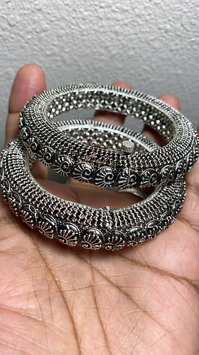 Silver bangles jewelry with screws. Indian jewelry