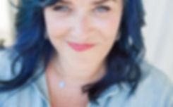 Blue smirk headshot
