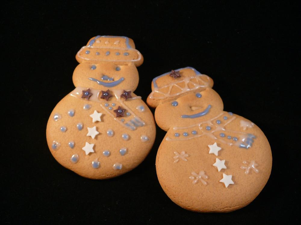 Two gingerbread snowmen.