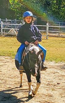 X riding Jonas.jpg