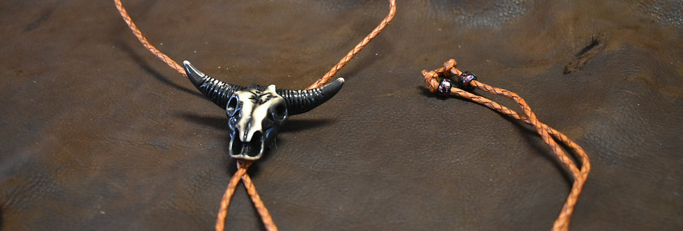 Cow skull necklace.