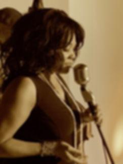 Jeannine at the Mic Singing.jpg