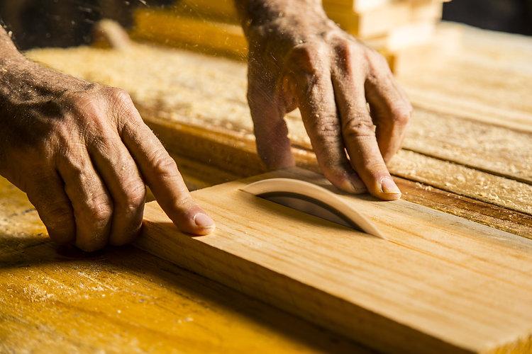 Man hands working in furniture wood indu