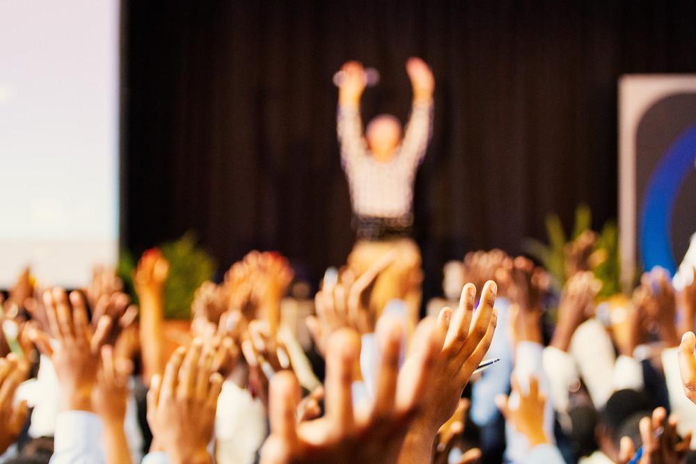 Hands raised at forum