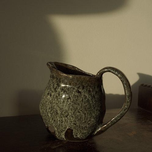 Hand formed milk jug