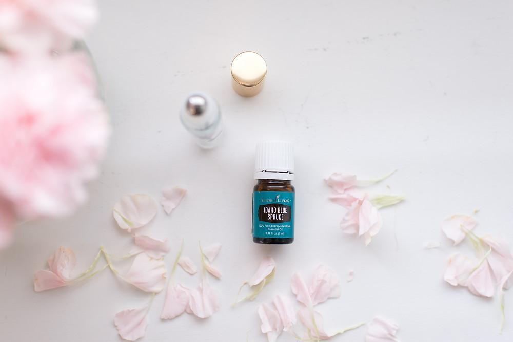 Idaho Blue Spruce, hormones, romance, intimacy, oils in the bedroom, massage oil, essential oils, young living, young living essential oils, Lucy libido, Roller bottle, flower petals, flower bouquet
