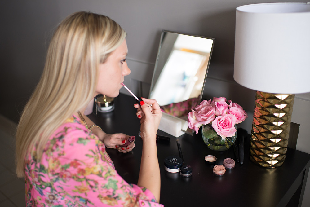 Savvy Make up, girl putting on lip gloss, savvy lipgloss, putting on make up, hormones, romance, intimacy, oils in the bedroom, massage oil, essential oils, young living, young living essential oils, Lucy libido