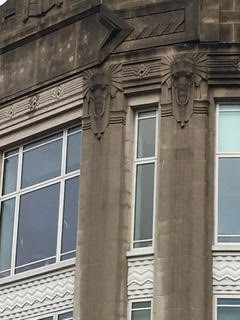 Stone carved art deco elephants on former Burton shop front