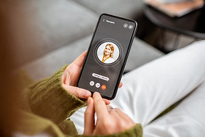 Woman making video call to a doctor usin
