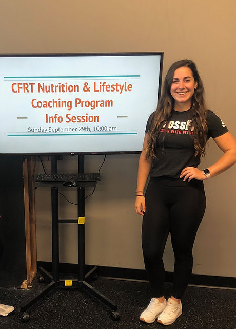 Woman standing next to screen with nutrition presentation