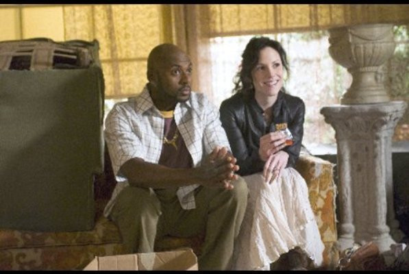 "Romany Malco and Mary-Louise Parker in ""Weeds."""
