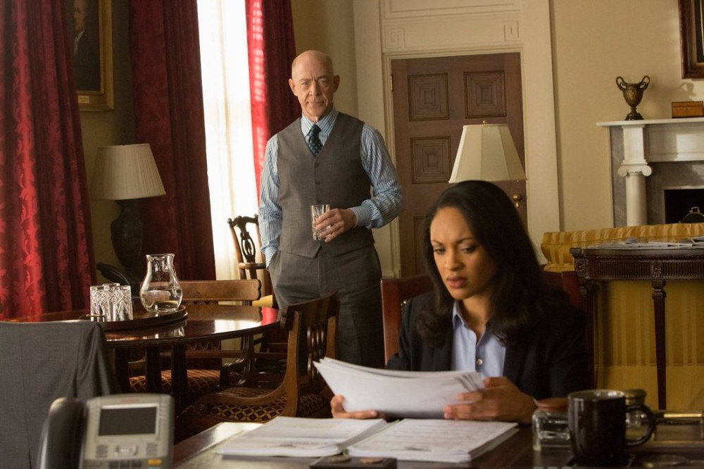 "Cynthia Addai-Robinson and JK Simmons in ""The Accountant."""