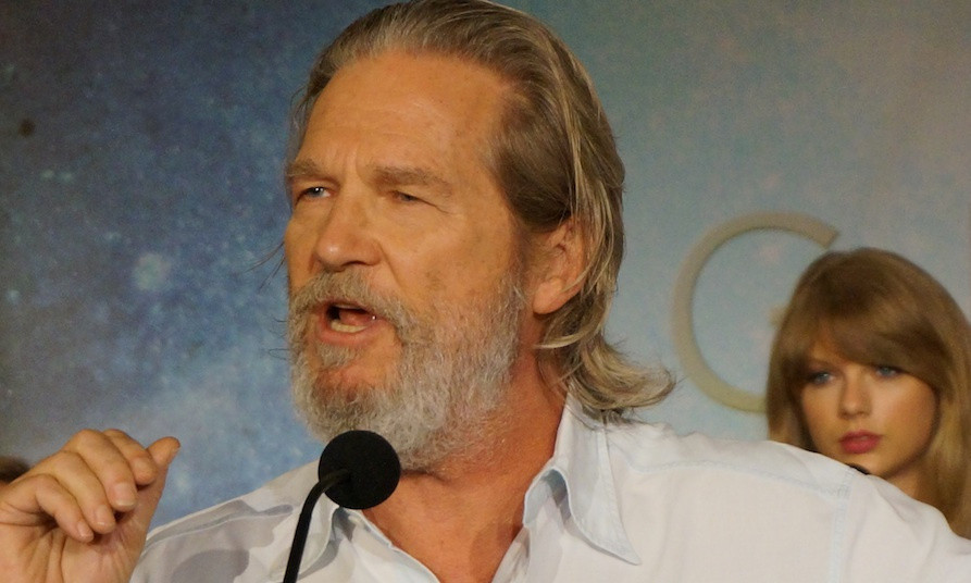 "Jeff Bridges (with Taylor Swift behind him) at the New York press conference for ""The Giver.""  Photo copyright 2014 Brad Balfour."